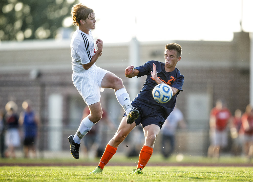 Rochester's Justin Meadows (21) and Glenwood's Owen Brown (3) nearly collide as the go for possession of the ball in the first half at Glenwood High School, Tuesday, Aug. 30, 2016, in Chatham, Ill. Justin L. Fowler/The State Journal-Register