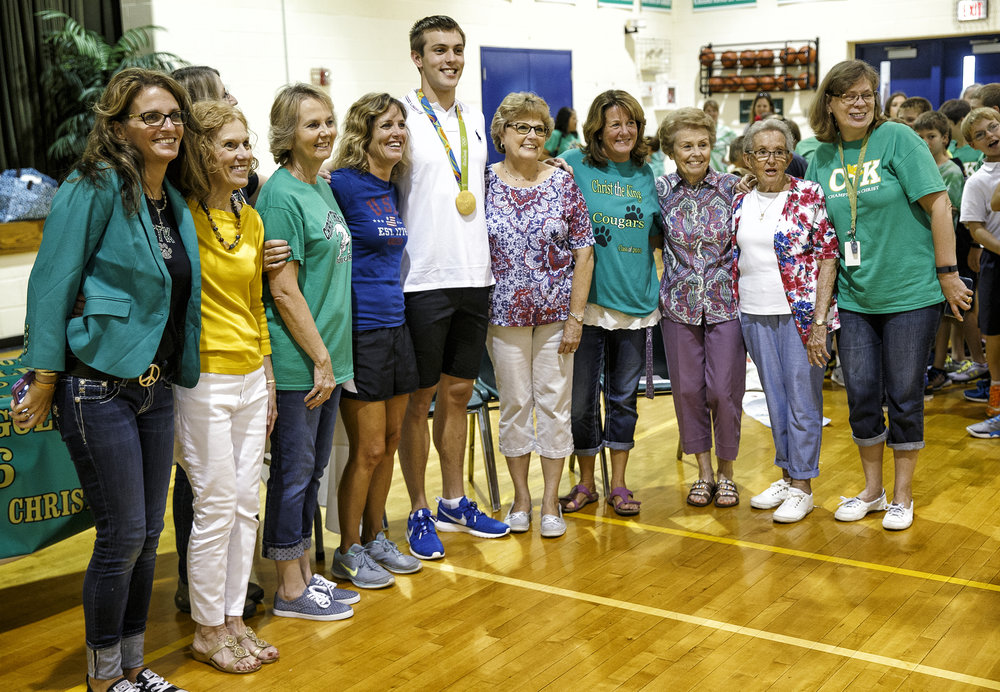 Sacred Heart-Griffin High School graduate Ryan Held poses for a photo with former teachers and staff at Christ the King School, which he is a 2010 graduate, during an assembly to celebrate his Olympic gold medal, Friday, Sept. 2, 2016, in Springfield, Ill. Justin L. Fowler/The State Journal-Register