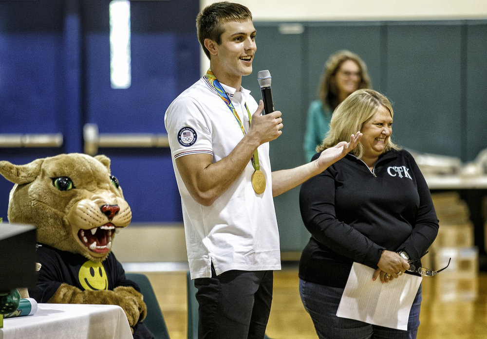 "Sacred Heart-Griffin High School graduate Ryan Held answers questions from Christ the King School principal Pam Fahey, right, including that his favorite food is a ""Horseshoe"" during an assembly to celebrate his Olympic achievements at his former school, Friday, Sept. 2, 2016, in Springfield, Ill. Justin L. Fowler/The State Journal-Register"