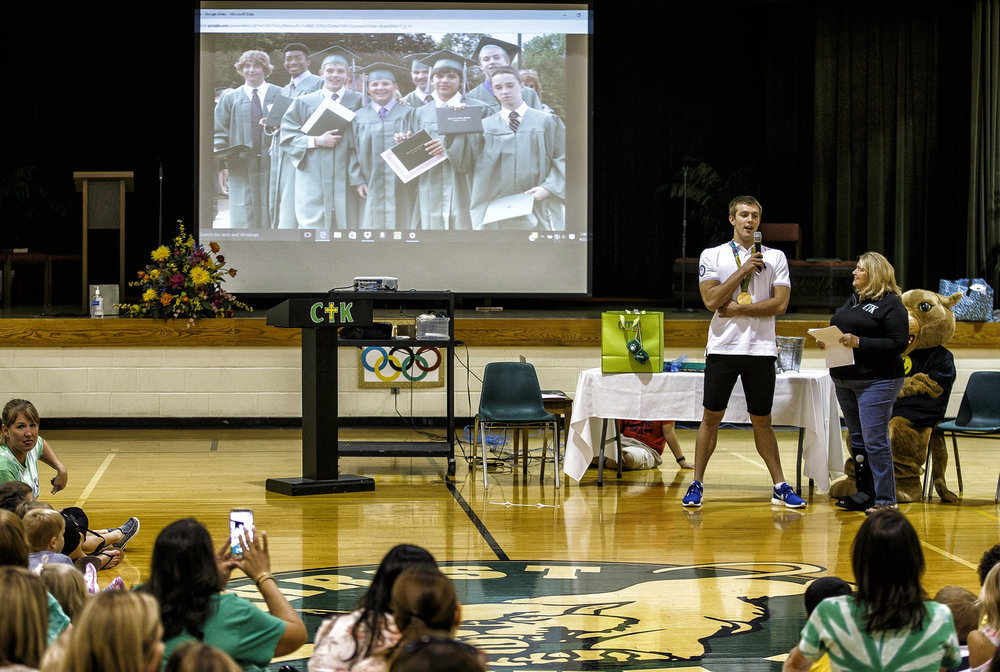 Sacred Heart-Griffin High School graduate Ryan Held answers questions from Christ the King School principal Pam Fahey, right, with a photo of his 2010 graduation on display during an assembly to celebrate his Olympic achievements at his former school, Friday, Sept. 2, 2016, in Springfield, Ill. Justin L. Fowler/The State Journal-Register
