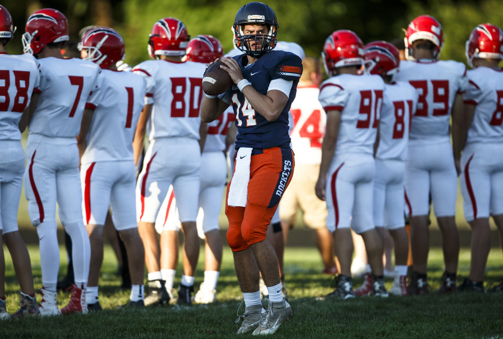 Rochester's Josh Grant (14) drops back for a pass during warm-ups as the Rockets prepare to take on Glenwood at Rocket Booster Stadium, Friday, Sept. 2, 2016, in Rochester, Ill. Justin L. Fowler/The State Journal-Register
