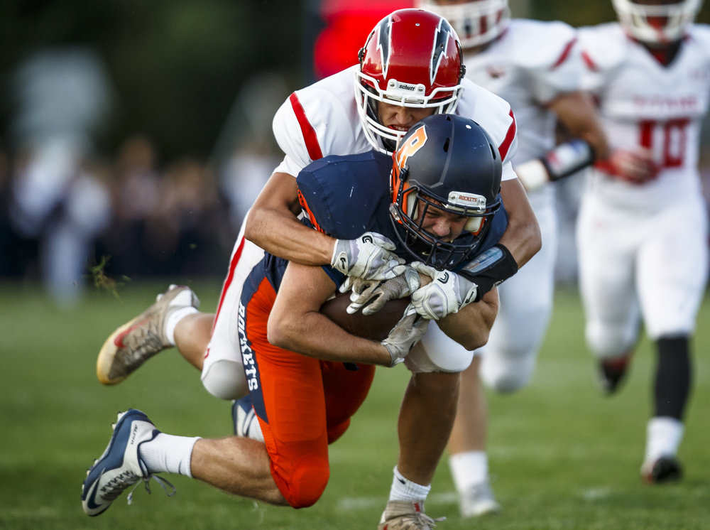 Rochester's Alec Ostermeier (32) is wrapped up by Glenwood's Stephan McCree (82) on a rush during the first half at Rocket Booster Stadium, Friday, Sept. 2, 2016, in Rochester, Ill. Justin L. Fowler/The State Journal-Register