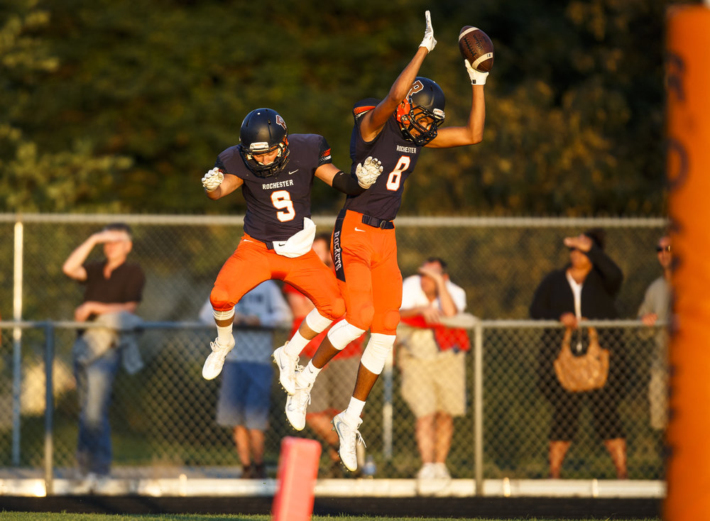 Rochester's Collin Stallworth (8) celebrates his touchdown with Rochester's Parker Flynn (9) against Glenwood during the first half at Rocket Booster Stadium, Friday, Sept. 2, 2016, in Rochester, Ill. Justin L. Fowler/The State Journal-Register