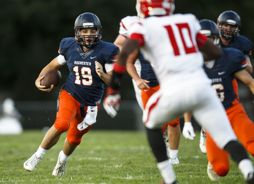 Rochester quarterback Nic Baker (19) takes off on run as he gets a block from Rochester's Cade Eddington (16) against Glenwood during the first half at Rocket Booster Stadium, Friday, Sept. 2, 2016, in Rochester, Ill. Justin L. Fowler/The State Journal-Register