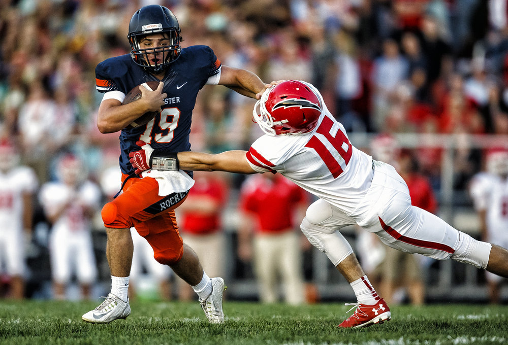 Rochester's Nic Baker (19) puts a stiff arm on Glenwood's Talen Vogler (16) as he takes off on a run during the first half at Rocket Booster Stadium, Friday, Sept. 2, 2016, in Rochester, Ill. Justin L. Fowler/The State Journal-Register