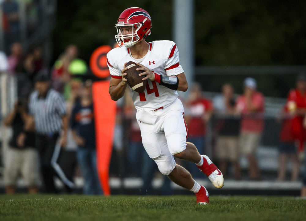Glenwood's Cole Hembrough (14) drops back for a pass against Rochester during the first half at Rocket Booster Stadium, Friday, Sept. 2, 2016, in Rochester, Ill. Justin L. Fowler/The State Journal-Register