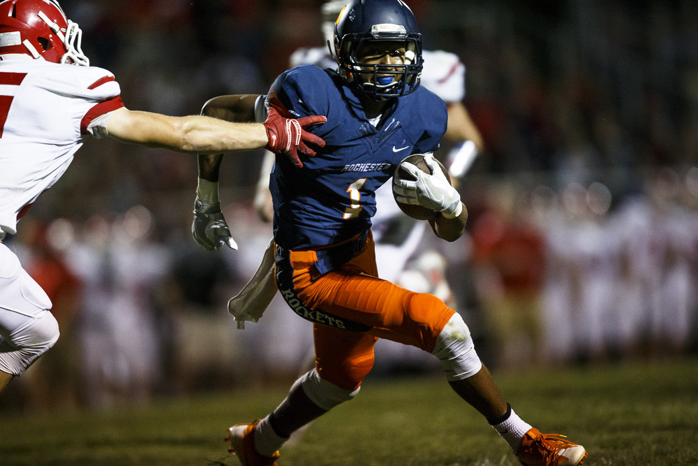 Rochester's D'Ante Cox (1) avoids a tackle from Glenwood's Talen Vogler (16) as he gains yardage after a catch during the first half at Rocket Booster Stadium, Friday, Sept. 2, 2016, in Rochester, Ill. Justin L. Fowler/The State Journal-Register