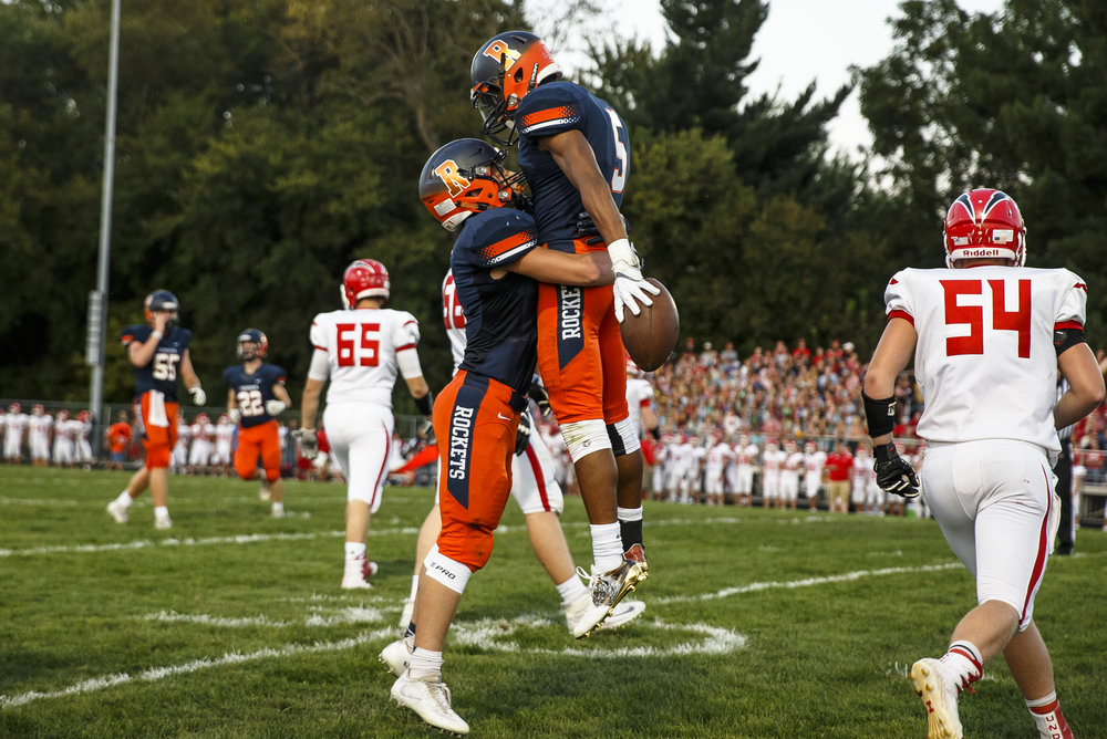 Rochester's Avante' Cox (5) celebrates a touchdown with Rochester's Skylor Caruso (11) against Glenwood during the first half at Rocket Booster Stadium, Friday, Sept. 2, 2016, in Rochester, Ill. Justin L. Fowler/The State Journal-Register
