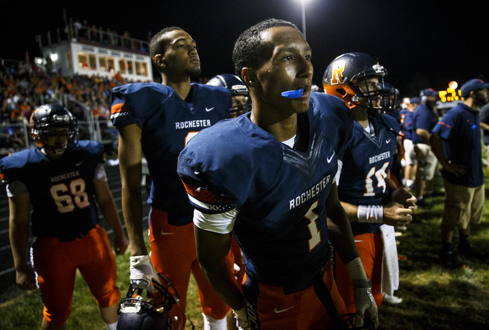 Rochester's D'Ante Cox (1) and Rochester's Collin Stallworth (8) watch as the defense tries to make a stop against Glenwood late in the first half at Rocket Booster Stadium, Friday, Sept. 2, 2016, in Rochester, Ill. Justin L. Fowler/The State Journal-Register