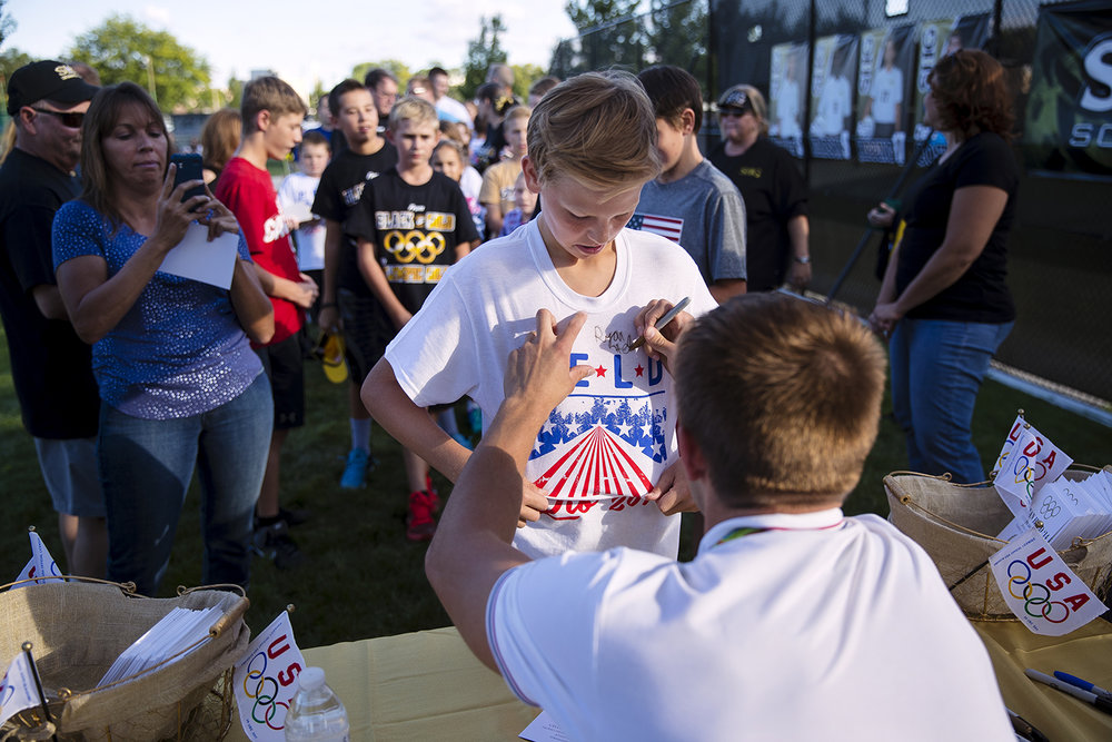 Ryan Held signs his autograph to a fans shirt during an event in his honor at Cyclone Stadium Friday, Sept. 2, 2016. Held, an SHG alum, was a member of the United States' first-place 4x100-meter relay team in the Rio de Janeiro 2016 Summer Olympics. Ted Schurter/The State Journal-Register
