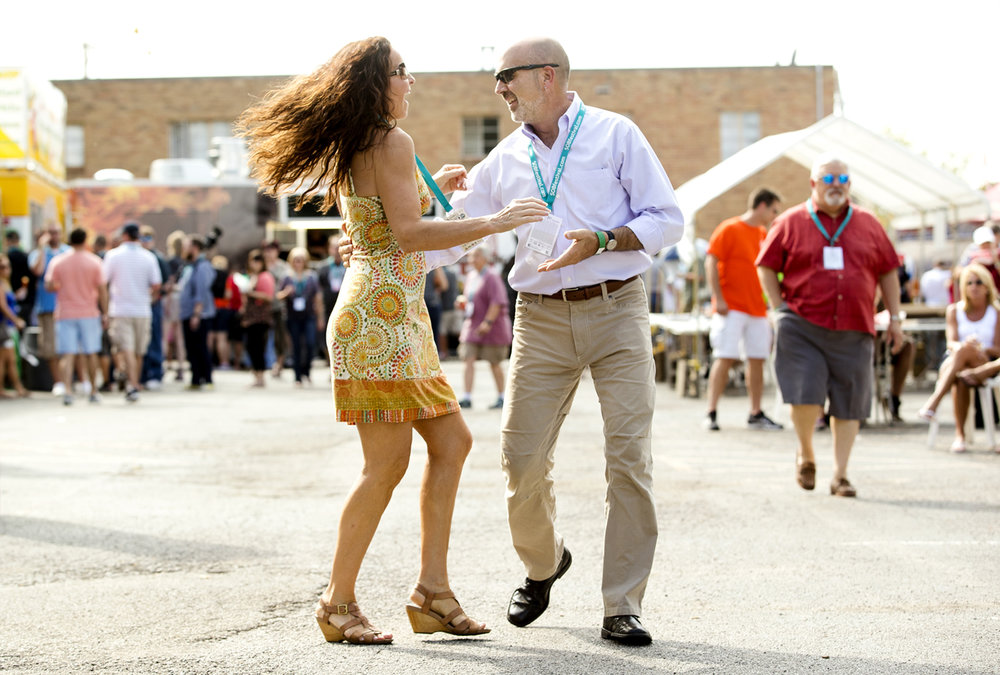 Paula Velten dances with Teddy Kreifels at the 7th Annual Springfield Oyster and Beer Festival in the parking lot of the Inn at 835 Saturday, Sept. 3, 2016. Guests could sample from more than three dozen different brewers, eat oysters or order from three food trucks while enjoying live music. Ted Schurter/The State Journal-Register