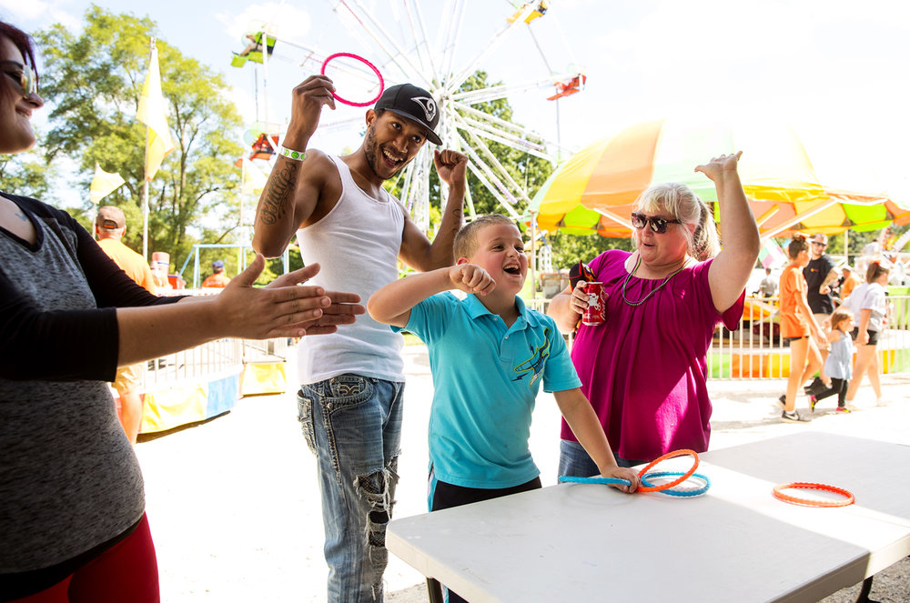 Tage Orrison celebrates with his mom Autumn, Antione Phillips and his grandmother Cindy Orrison after winning at ring toss during the Kincaid Labor Day Picnic Sunday, Sept. 4, 2016. The picnic continues today with Bocce ball and washers tournaments as well as a talent and car show. Ted Schurter/The State Journal-Register