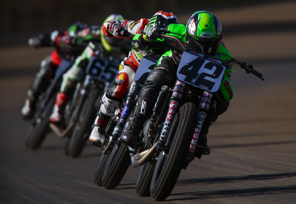 Bryan Smith leads the pack out of turn four during the AMA Pro Flat Track Springfield Mile II at the Illinois State Fairgrounds Sunday, Sept. 4, 2016. Cory Texter, right, placed third. Ted Schurter/The State Journal-Register