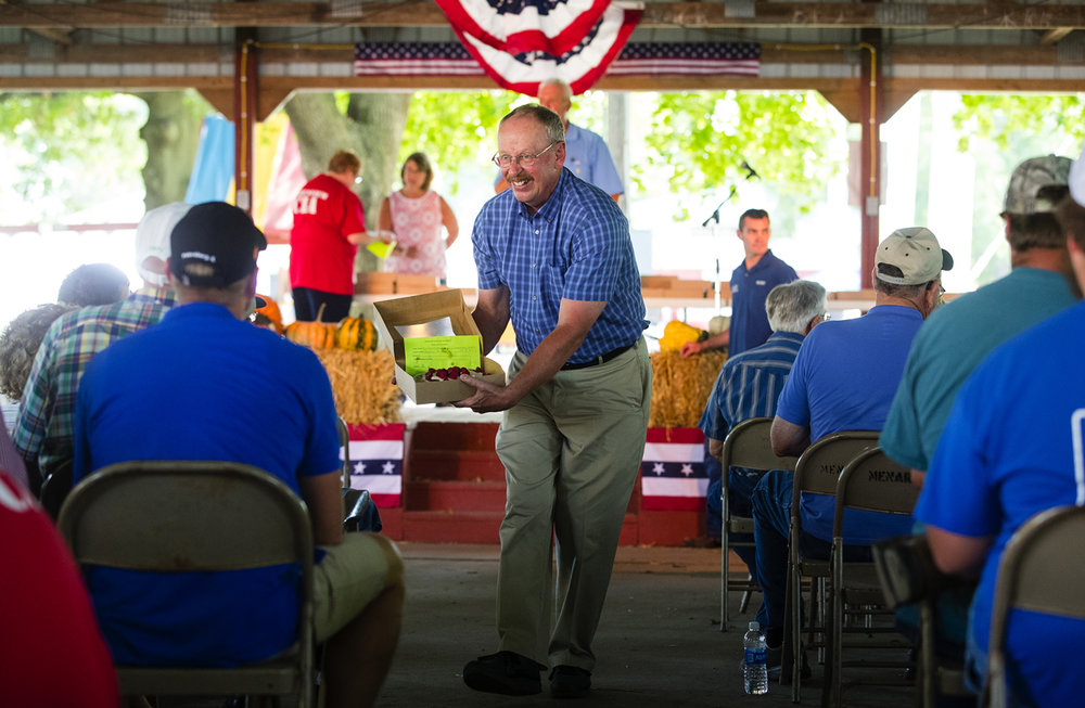 Former Menard County Sheriff Larry Smith displays one of the 55 pies available for sale during the homemade pie contest and auction at the 48th Annual Greenview Labor Day Celebration Monday, Sept. 5, 2016. The contest began as a cake contest but switched to pies years ago to satisfy local demand. A grand champion pie can sell for more than $200 and proceeds benefit the Greenview Community Building. Ted Schurter/The State Journal-Register