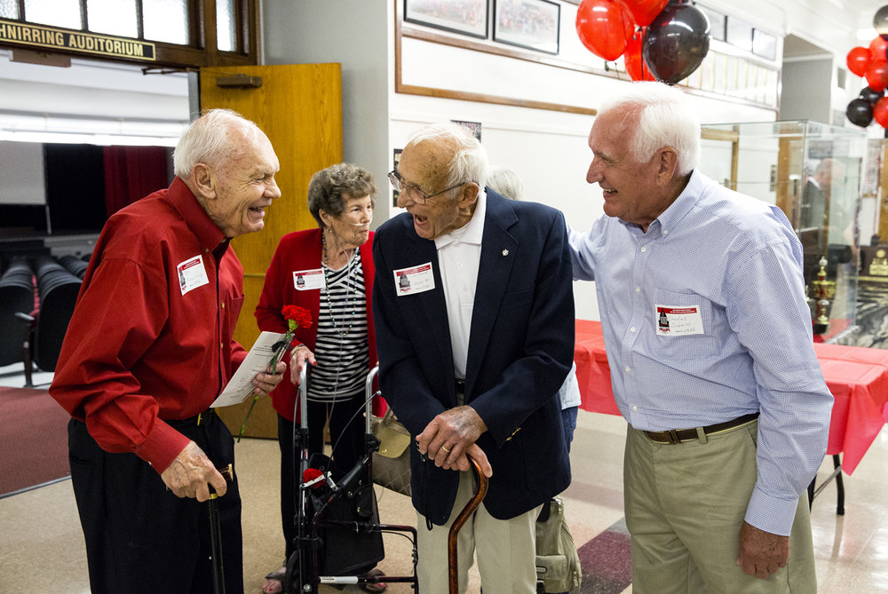 Bill Schnirring, left, and Al Schmid, visit during the Springfield High School 100 year anniversary celebration at the school Friday, Sept. 9, 2016. Schnirring and his wife, Mary, in red jacket, graduated in 1946 and Schmid is from the class of 1947. Accompanying Al Schmid is his brother, Charlie, who graduated from the school in 1955. Rich Saal/The State Journal-Register