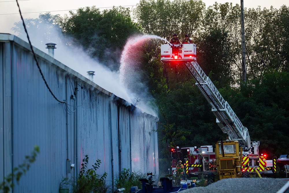 Springfield firefighters spray water on the backside of Hobb-e-Mart, 2875 N. Dirksen Parkway, as they try to extinguish the fire Tuesday, Sept. 13, 2016. Ted Schurter/The State Journal-Register