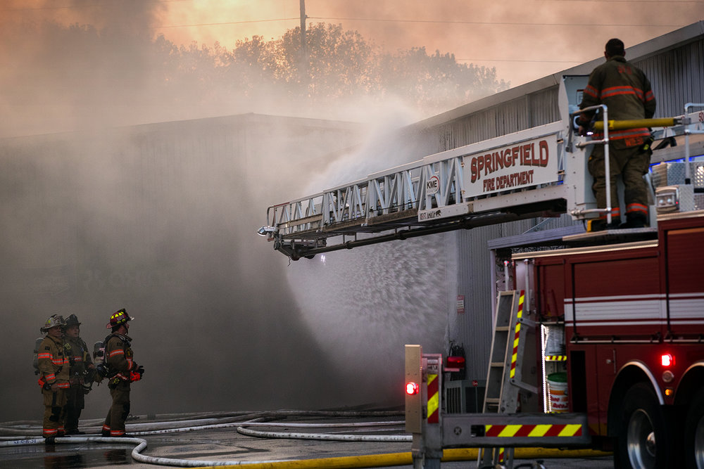 Springfield firefighters use a ladder truck to spray water into an open door of Hobb-e-Mart, 2875 N. Dirksen Parkway, as they try to get the fire under control Tuesday, Sept. 13, 2016. Ted Schurter/The State Journal-Register