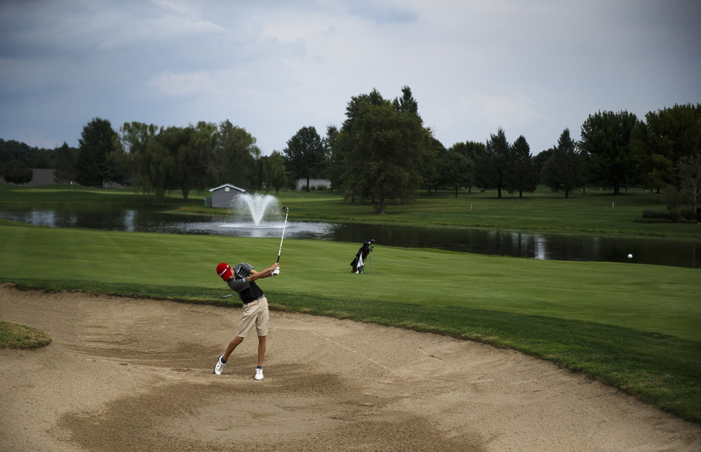Springfield sophomore Adler Boatman hits his second shot out of the sand on the No. 2 hole during the final round of the Boys City Golf Tournament at Panther Creek Country Club, Thursday, Sept. 15, 2016, in Springfield, Ill. Justin L. Fowler/The State Journal-Register