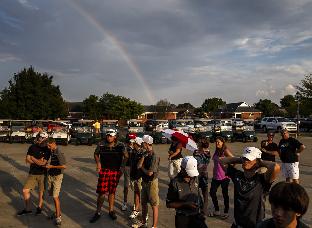 A rainbow pops out of the clouds as players gather around the scoreboard for the final tallies during the final round of the Boys City Golf Tournament at Panther Creek Country Club, Thursday, Sept. 15, 2016, in Springfield, Ill. Justin L. Fowler/The State Journal-Register