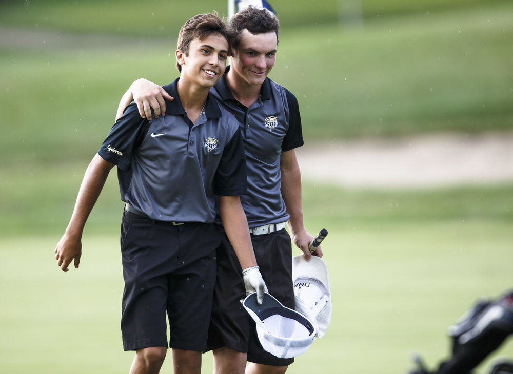 Sacred Heart-Griffin senior Gannon Handley, right, gives  freshman Reid Taylor, left, a hug after they finished their round on the No. 9 hole during the final round of the Boys City Golf Tournament at Panther Creek Country Club, Thursday, Sept. 15, 2016, in Springfield, Ill. Taylor finished 1st in the tournament overall and Handley finished 3rd. Justin L. Fowler/The State Journal-Register