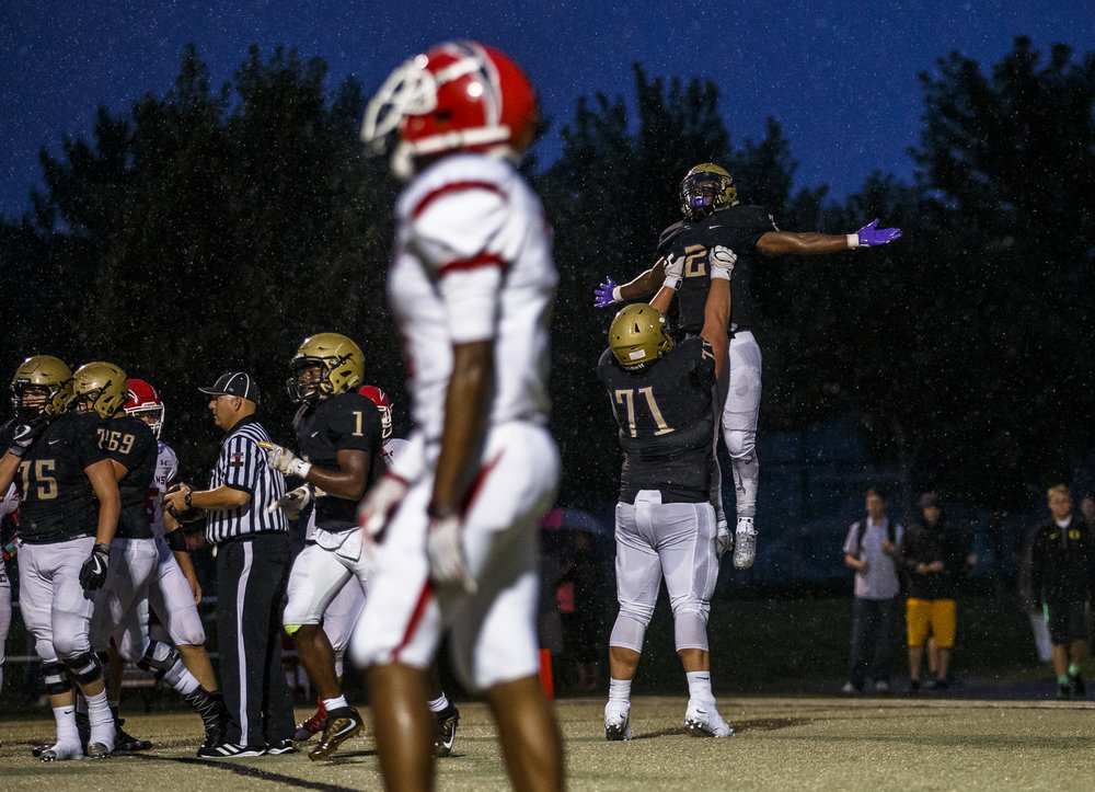 Sacred Heart-Griffin's Tremayne Lee (2) is hoisted up in the air by Sacred Heart-Griffin's John Pempek (71) after scoring his second touchdown against Glenwood in the first half at the SHG Sports Complex, Friday, Sept. 16, 2016, in Springfield, Ill. Justin L. Fowler/The State Journal-Register