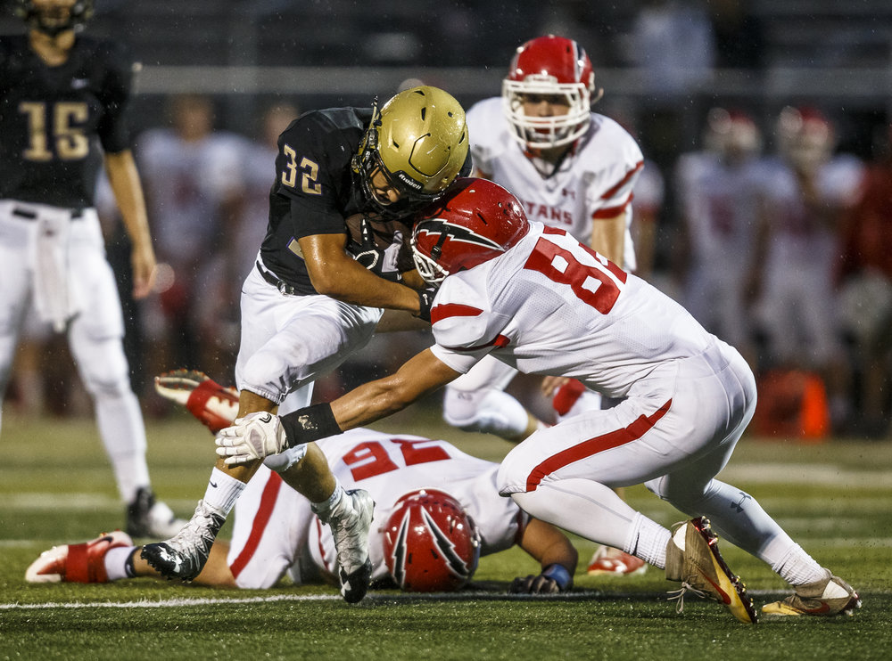 Sacred Heart-Griffin's Tristan Blair (32) lowers his shoulder into Glenwood's Stephan McCree (82) on a rush in the first half at the SHG Sports Complex, Friday, Sept. 16, 2016, in Springfield, Ill. Justin L. Fowler/The State Journal-Register