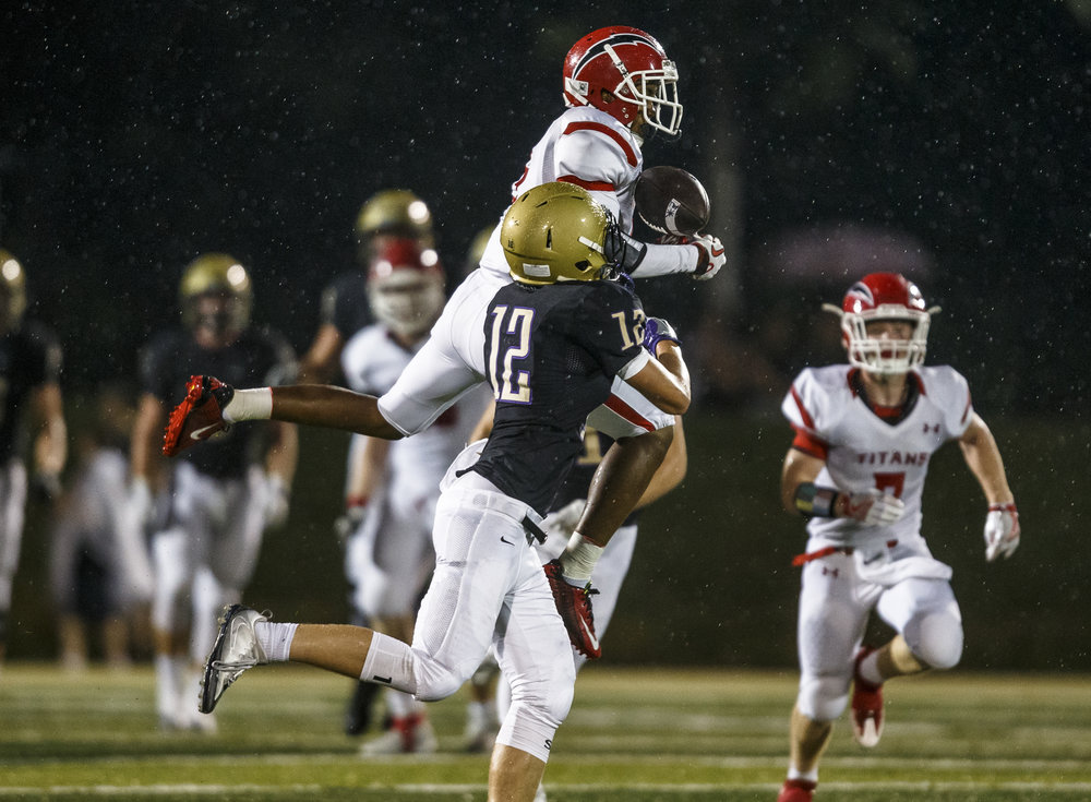 Glenwood's JJ Cal (5) nearly intercepts a pass intended for Sacred Heart-Griffin's Sam Raes (12) in the first half at the SHG Sports Complex, Friday, Sept. 16, 2016, in Springfield, Ill. Justin L. Fowler/The State Journal-Register