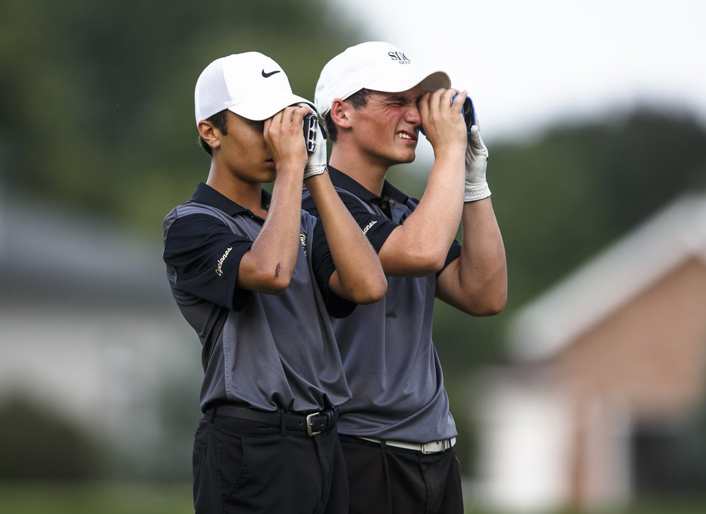 Sacred Heart-Griffin freshman Reid Taylor, left, and senior Gannon Handley, right, use range finders off the tee on the No. 8 hole during the final round of the Boys City Golf Tournament at Panther Creek Country Club, Thursday, Sept. 15, 2016, in Springfield, Ill. Justin L. Fowler/The State Journal-Register