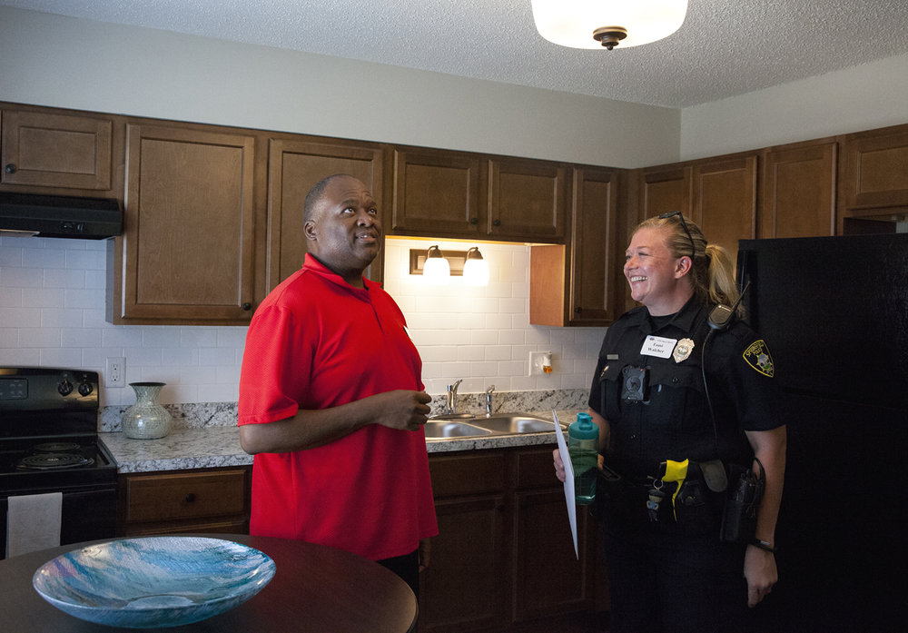 Brian Burton conducts a tour of a renovated two bedroom townhouse for Springfield Police Officer Tami Walcher Thursday, Sept. 15, 2016 during an open house at the former MacArthur Park apartment complex, now known as The Boulevard. Walcher is the neighborhood patrol officer for the area and Burton is property manager for owner Cohen-Esrey. Rich Saal/The State Journal-Register