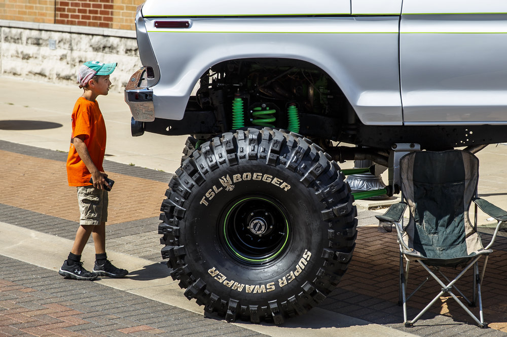 "Jake Jenkins, 10, of Decatur, Ill., tests his height compared to an F-150 named ""Fordzilla"" on display during 15th annual International Route 66 Mother Road Festival & Car Show, Saturday, Sept. 24, 2016, in Springfield, Ill. Justin L. Fowler/The State Journal-Register"