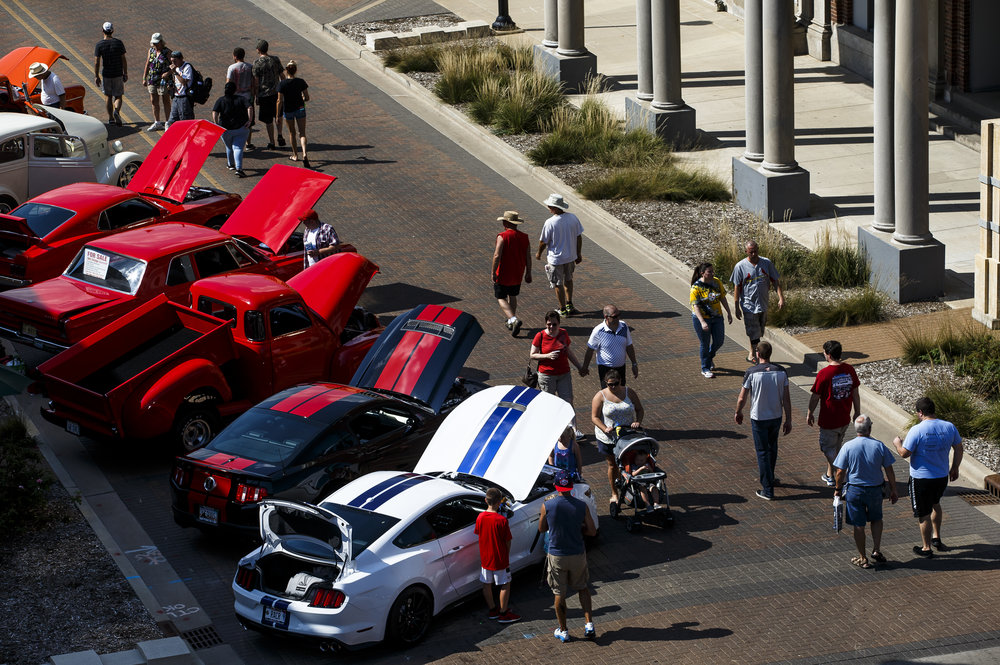 Vistors make their way down Capitol Avenue taking in the cars on display during 15th annual International Route 66 Mother Road Festival & Car Show, Saturday, Sept. 24, 2016, in Springfield, Ill. Justin L. Fowler/The State Journal-Register