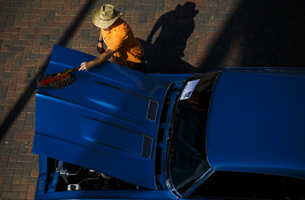Steve Chard wipes down the hood of his 1969 Chevrolet  Chevelle parked on Capitol Avenue during 15th annual International Route 66 Mother Road Festival & Car Show, Saturday, Sept. 24, 2016, in Springfield, Ill. Justin L. Fowler/The State Journal-Register