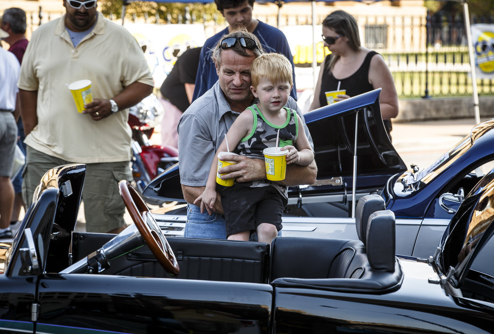 Matt Reecy, of Peoria, Ill., holds up his grandson Blake Pearson, 5, so he can peak into the interior of one of over 1,200 cars on display during 15th annual International Route 66 Mother Road Festival & Car Show, Saturday, Sept. 24, 2016, in Springfield, Ill. Justin L. Fowler/The State Journal-Register