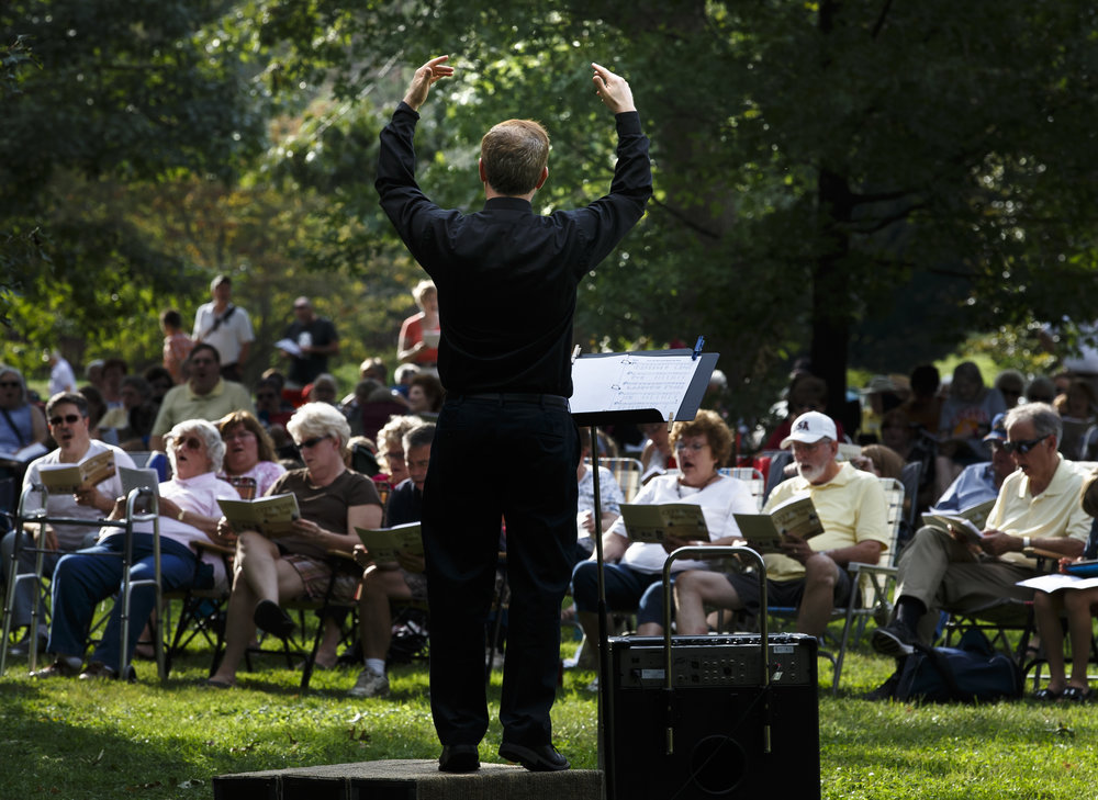 Hymn Leader J.B. George, of Grace Lutheran Church, aids the crowd in singing along with the hymns during the City Wide Hymn Fest at the Thomas Rees Memorial Carillon in Washington Park, Sunday, Sept. 25, 2016, in Springfield, Ill. Justin L. Fowler/The State Journal-Register