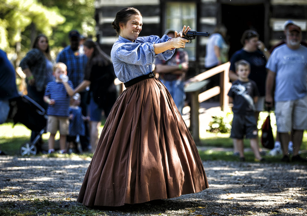 Civil War reenactor Amy Barger, performing as Miss Clara Barton, tries a quick draw shootout for the first time during the Clayville Fall Festival at the Clayville Historical Site, Sunday, Sept. 18, 2016, in Pleasant Plains, Ill. Justin L. Fowler/The State Journal-Register