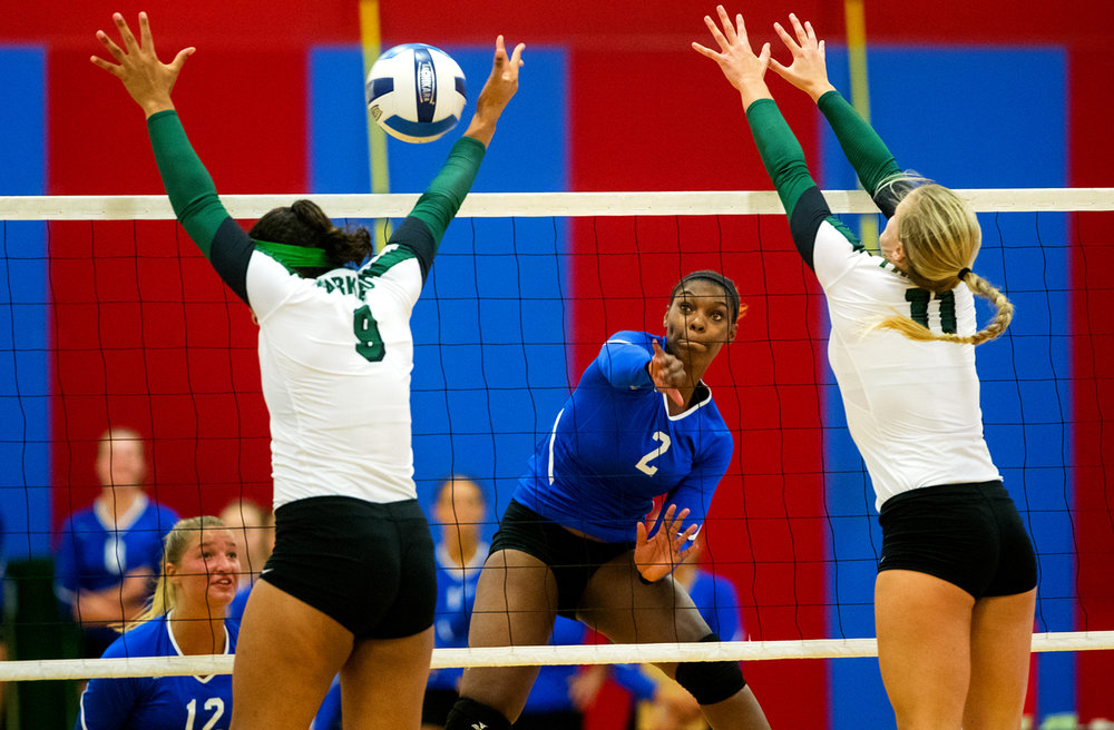 Lincoln Land Community College's Talesha Scott spikes the ball past two Parkland defenders during a Mid-West Athletic Conference volleyball match at Cass Gymnasium Wednesday, Sept. 22, 2016. Ted Schurter/The State Journal-Register