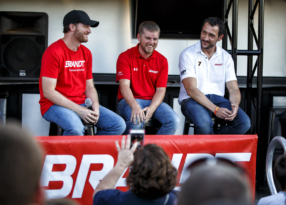 """Justin Allgaier, center, laughs after explaining that anyone visiting Springfield needs to try a """"Horseshoe"""" during a Q&A with NASCAR driver Dale Earnhardt Jr., left, and Porsche GT3 Cup driver Miguel Paludo, right, at the Brandt Headquarters, Thursday, Sept. 22, 2016, in Springfield, Ill.  Earnhardt is the owner of JR Motorsports, the team that Allgaier drives for in the #7 NASCAR Xfinity Series stock car sponsored by Brandt. Justin L. Fowler/The State Journal-Register"""