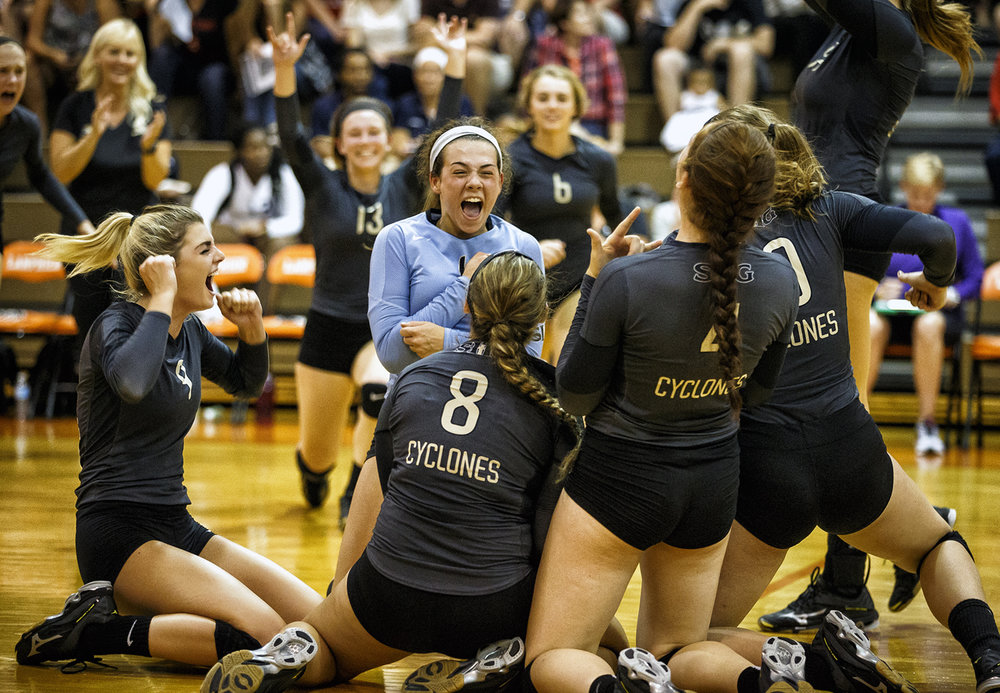 Sacred Heart-Griffin libero Mary Helen Healy, center, hits the floor celebrate the with her teammates after the Cyclones defeated Springfield 25-18, 25-19 to win their 31st City Volleyball Tournament title at Lanphier High School, Thursday, Sept. 22, 2016, in Springfield, Ill. Justin L. Fowler/The State Journal-Register