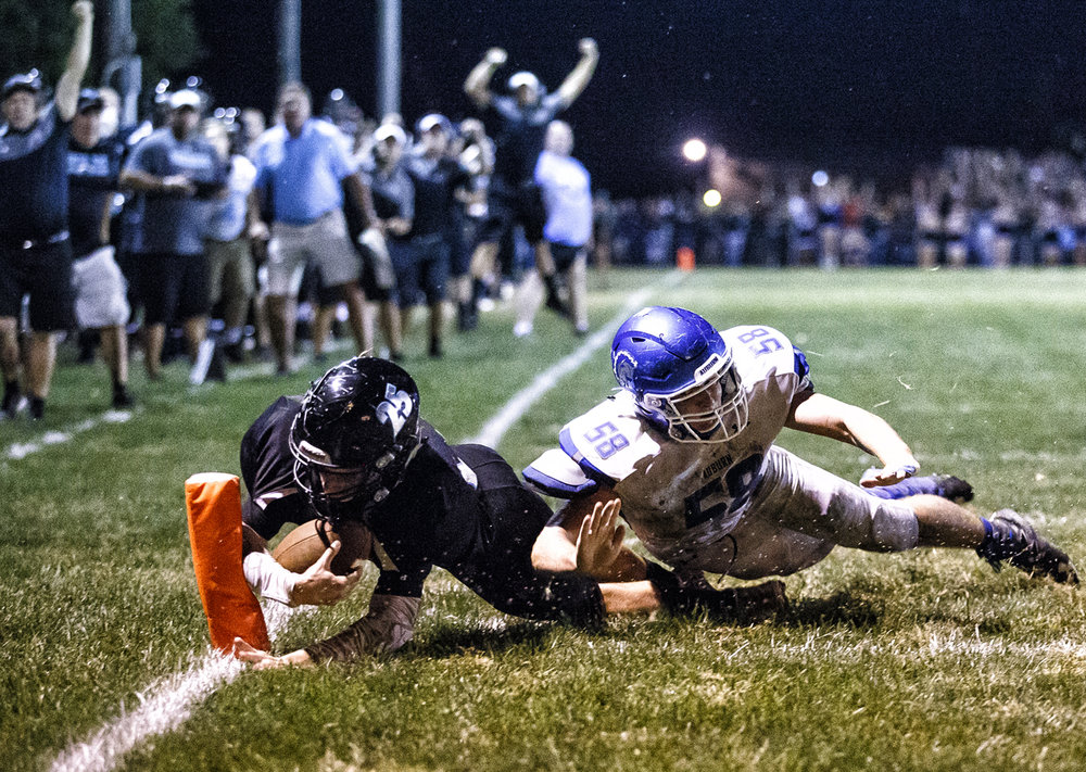 North Mac's Kendall Bearden (25) dives for the goal line against Auburn's Tyler Bridges (58) on the two point conversion to score two and put North Mac up 15-14 with 24 seconds left in the game at North Mac High School, Friday, Sept. 23, 2016, in Virden, Ill. Justin L. Fowler/The State Journal-Register