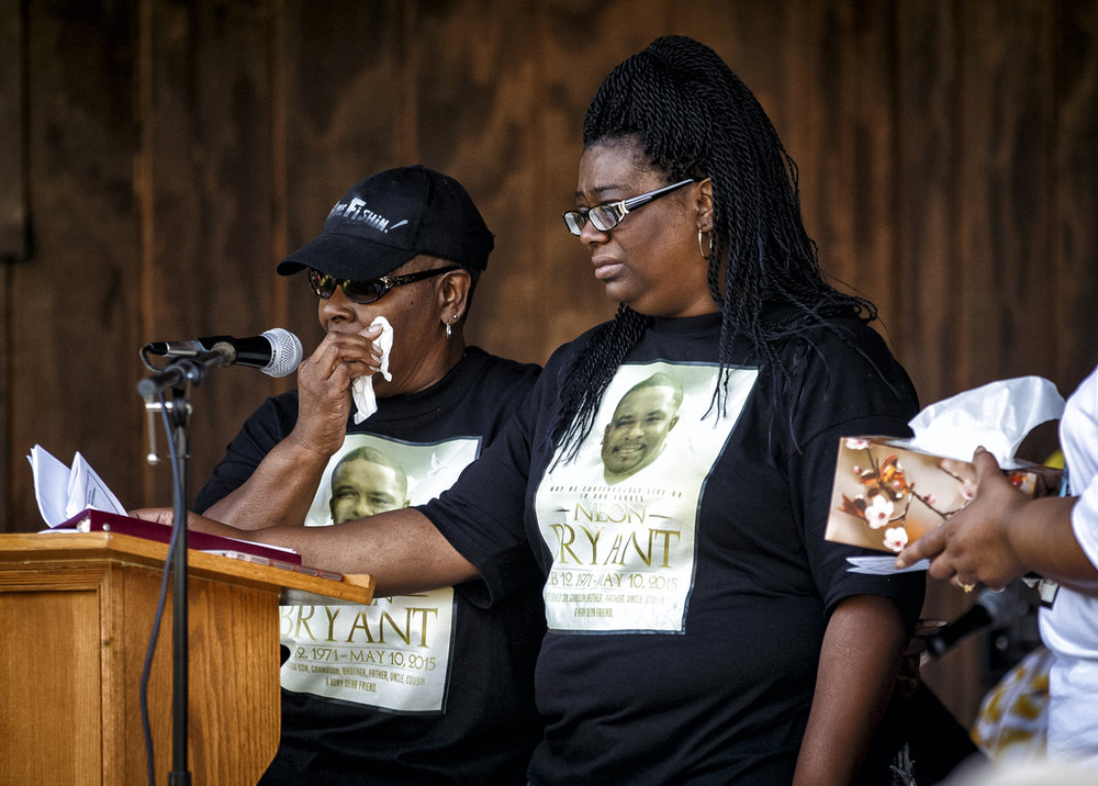 Katie Bryant, left, wipes away her tears as she stands at the podium with her daughter, Natosha Bryant, right, as she tells the story of her son, Neon Bryant, who was murdered on Mother's Day in 2015, during a remembrance ceremony sponsored by the Sponsored by Voices of those who Have been Silenced by Violence and The United Methodist Women of Grace at Grace United Methodist Church, Saturday, Sept. 24, 2016, in Springfield, Ill. Justin L. Fowler/The State Journal-Register