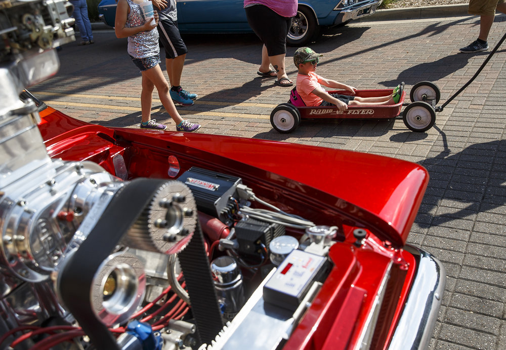 Hunter Courtney, 5, hitches a ride on a custom made Radio Flyer wagon during 15th annual International Route 66 Mother Road Festival & Car Show, Saturday, Sept. 24, 2016, in Springfield, Ill. Justin L. Fowler/The State Journal-Register