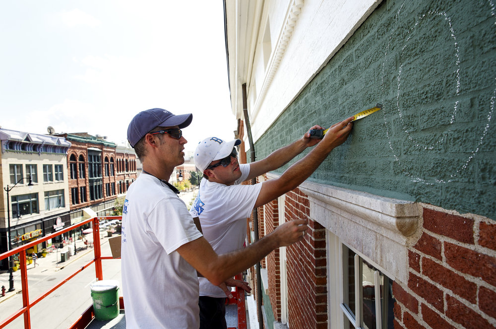 Troy Freeman, left, and Brandon Turley measure the spacing for letters Tuesday, Sept. 20, 2016 on the Lincoln Herndon Law Office, also known as the Tinsley Building at Sixth and Adams streets in Springfield, Ill. Exterior repair work includes the recreation of hand-lettered signs that wrapped around the building at the time Lincoln had his law practice there. Freeman is owner of Free Sky Studios. Rich Saal/The State Journal-Register