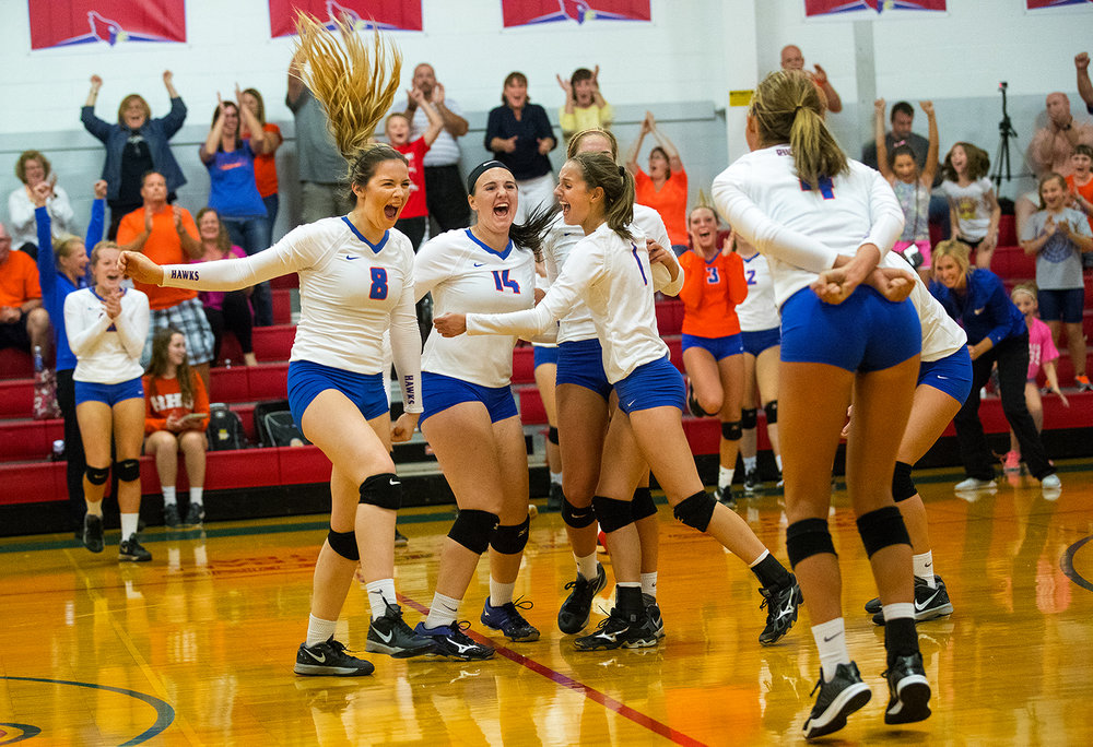 The Riverton Hawks celebrate their victory against Williamsville during the Sangamon County Volleyball Tournament championship game at Pleasant Plains High School Monday, Sept. 26, 2016. Ted Schurter/The State Journal-Register