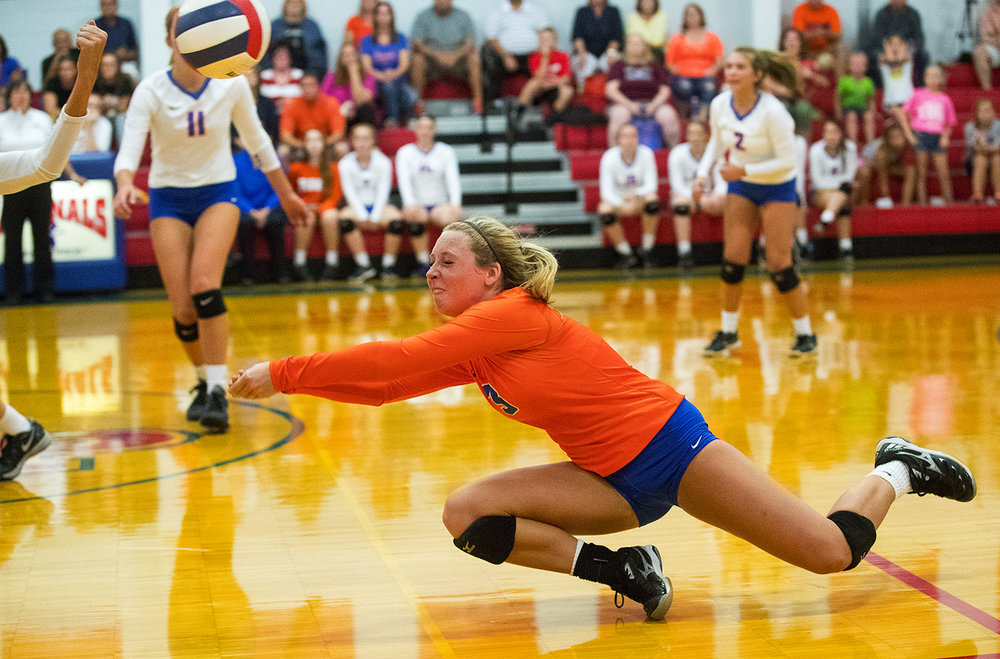 Riverton's Adriana Ray dives for a dig against Pleasant Plains during the Sangamon County Volleyball Tournament championship game at Pleasant Plains High School Monday, Sept. 26, 2016. Ted Schurter/The State Journal-Register