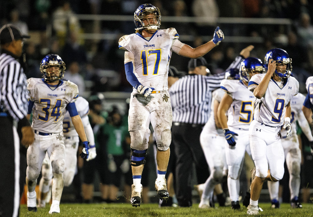 Maroa-Forsyth's Logan Allsup (17) celebrates an interception against Athens in the second half at Athens High School, Friday, Sept. 30, 2016, in Athens, Ill. Justin L. Fowler/The State Journal-Register