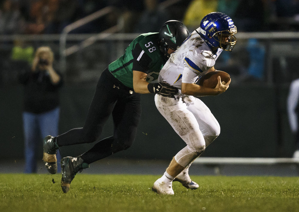 Athens' Noah Tisdale (58) brings down Maroa-Forsyth quarterback Tyler Ray (8) as he scrambles out of the pocket in the second half at Athens High School, Friday, Sept. 30, 2016, in Athens, Ill. Justin L. Fowler/The State Journal-Register
