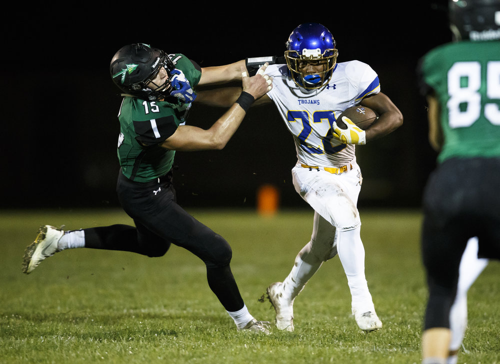 Maroa-Forsyth's Deondre Gregory (22) puts a stiff arm on Athens' Hunter Maxwell (15) on a rush in the first half at Athens High School, Friday, Sept. 30, 2016, in Athens, Ill. Justin L. Fowler/The State Journal-Register