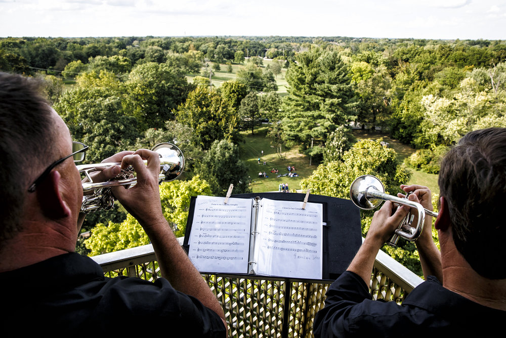 Trumpet descants Dan McCaffrey, left, and Dennis Jones, right, play along with Carillonist Carlo van Ulft on the balcony on the eighth floor of the Thomas Rees Memorial Carillon looking westward over Washington Park during the City Wide Hymn Fest, Sunday, Sept. 25, 2016, in Springfield, Ill. The event was a collaboration to celebrate the 175th anniversary of both Grace Lutheran Church and Trinity Evangelical Lutheran Church who share a history in that they originated from the same church. Justin L. Fowler/The State Journal-Register