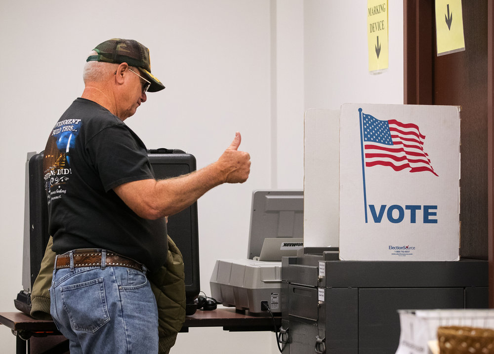 Patrick Pierceall gives a thumbs up after casting his early vote at the Sangamon County election office at the Sangamon County Complex, 200 S. Ninth St., Thursday, Sept. 29, 2016. Ted Schurter/The State Journal-Register