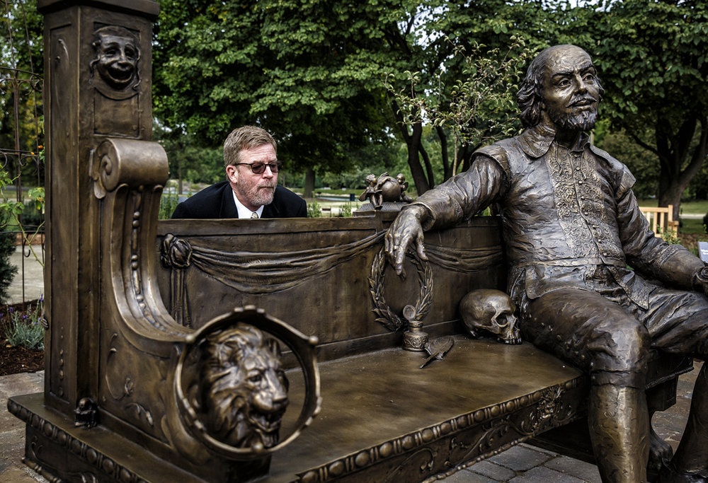 Eric Thibodeaux-Thompson, director of the University of Illinois Springfield Theatre Dept., looks over the inscription on the rear of Gary Lee Price's bronze sculpture of William Shakespeare after it was unveiled during the dedication the new Shakespeare's Garden on the campus of UIS, Thursday, Sept. 29, 2016, in Springfield, Ill. The garden also has a fountain along with the bench and includes plants and flowers mentioned in Shakespeare's plays and poems. Justin L. Fowler/The State Journal-Register